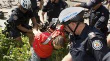 A protester is arrested by police following a protest in Toronto on June 21, 2010. (Kevin Van Paassen/Kevin Van Paassen/The Globe and Mail)