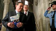 Prime Minister Stephen Harper and Finance Minister Jim Flaherty enter the House of Commons to deliver the federal budget on March 29, 2012. (Dave Chan/Dave Chan for The Globe and Mail)