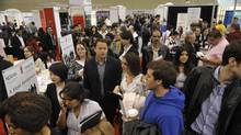 Hundreds line up for various booths at the The National Job Fair & Training Expo at the Metro Toronto Convention Centre last year. (J.P. MOCZULSKI For The Globe and Mail)