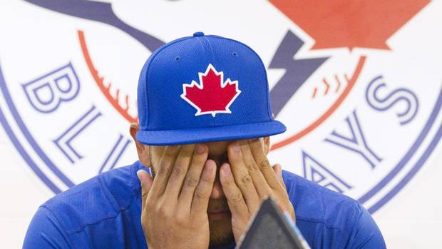 Toronto Blue Jays' Melky Cabrera reacts as he speaks to the media at the team's MLB baseball spring training facility in Dunedin, Florida February 15, 2013. (FRED THORNHILL/REUTERS)