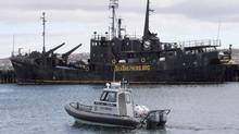 A Canadian Fisheries and Oceans patrol boat passes by the Sea Shepherd Conservation Society vessel Farley Mowat on Monday April 14, 2008, in Sydney, N.S. (Mike Dembeck/THE CANADIAN PRESS)