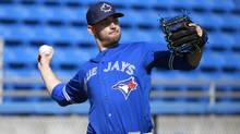 Toronto Blue Jays pitcher Marco Estrada decided to try a new exercise and his back has not been the same since. (Kim Klement/USA Today Sports)