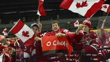 Canadian fans cheer prior to the World Junior Hockey Championships semifinal between Canada and Finland at Malmo Arena in Malmo, Sweden on Saturday, Jan. 4. (LUDVIG THUNMAN / TT/AP)
