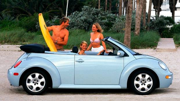 New Beetle Cabriolet: the curvy shape and dash-mounted flower vase made the New Beetle popular with women. The cabriolet version upped the ante. (The man in the photo is removing his surfboard and walking to the beach rather than ride in the Emasculator GT.) (Volkswagen)