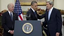 Vice-President Joe Biden looks on as President Barack Obama shakes hands with Senator John Kerry, nominated Friday for the job of secretary of state, replacing Hillary Clinton. (Carolyn Kaster/AP)