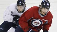Winnipeg Jets' Maxime Macenauer (left) and Zach Redmond skate on day three of training camp in Winnipeg on Tuesday, January 15, 2013. (The Canadian Press)