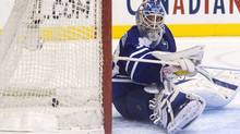 Toronto Maple Leafs goaltender Jonas Gustavsson sits on the ice as the puck nestles in the back of the net after Philadelphia Flyers' Claude Giroux scores the winning shoot out goal in NHL hockey action in Toronto on Saturday March 10, 2012.THE CANADIAN PRESS/Chris Young (Chris Young)