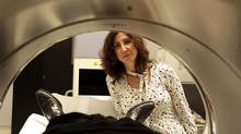 Romina Mizrahi looks into a Positron Emission Tomography (PET scan) machine, which provides a three-dimensional look at the body. Dr. Mizrahi is studying the brains of a dozen young people, aged 18-35, who are at risk of developing schizophrenia. (Julian Liurette/The Globe and Mail)