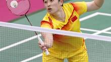 China's Yu Yang hits a return next to team mate Wang Xiaoli (not seen) against South Korea's Jung Kyung-eun and Kim Ha-na during their women's doubles group play stage Group A badminton match during the London 2012 Olympic Games at the Wembley Arena in this July 31, 2012 file photograph. (BAZUKI MUHAMMAD/REUTERS)